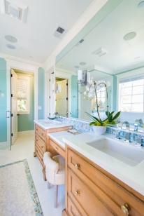 Dual sinks make getting ready a breeze in the master bath. Tile shown: Agate 1x1 in Firenze Pearl by Lunada Bay Tile. Photo: Jennifer Allison Design.